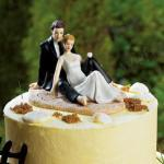 Romantic Wedding Couple Lounging on the Beach Figurine image